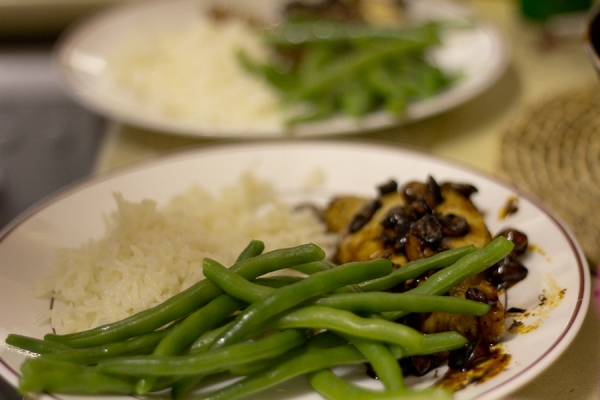 Pork clementine with green beans and rice on plates