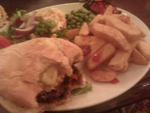 Burger with chips and peas